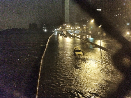 Paul Judelson, The FDR Drive flooded. A taxi that didn't make it. UN Building in background.