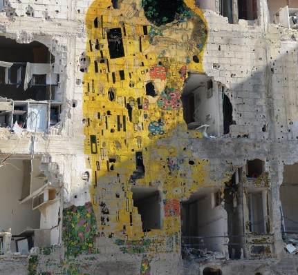"""Freedom Graffiti,"" a work by Syrian artist Tammam Azzam, who superimposed Gustav Klimt's ""The Kiss"" on to an image of a Syrian bombsite.  Tammam Azzam is represented by Ayyam Gallery, www.ayyamgallery.com"